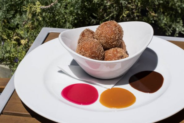 Gertrude's Donuts + Sauces feature ricotta donuts with smoke hot fudge, salted caramel, and prickly pear jelly