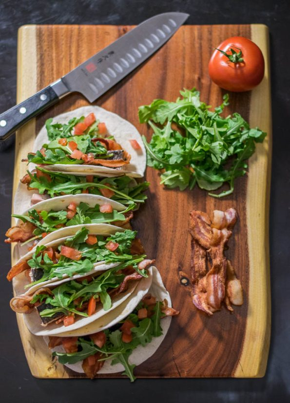 Salmon BLT Tacos are the perfect way to combine salmon and the quintessential diner sandwich into one delicious Taco Tuesday meal! 2geekswhoeat.com #tacos #bacon