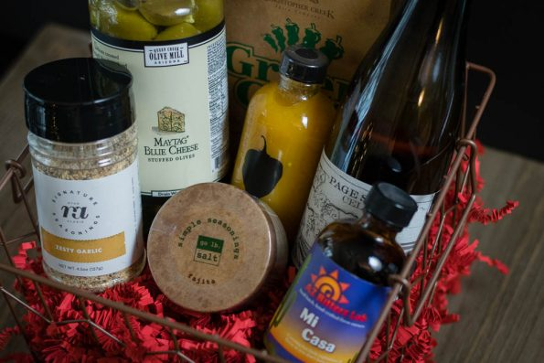 Gift baskets full of local products are a great way to share your state with loved ones who live far away! 2geekswhoeat.com #shoplocal #foodie
