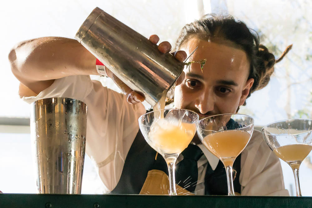 Gavin Pena pouring his cocktail
