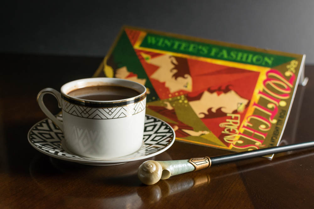 Witches, Wizards, and No-Maj alike will love our Fantastic Beasts inspired recipe for Queenie's Hot Chocolate! 2geekswhoeat.com #HotChocolate #HarryPotter #HarryPotterRecipes #HotCocoa #FantasticBeasts #HarryPotterRecipes #DrinkIdeas