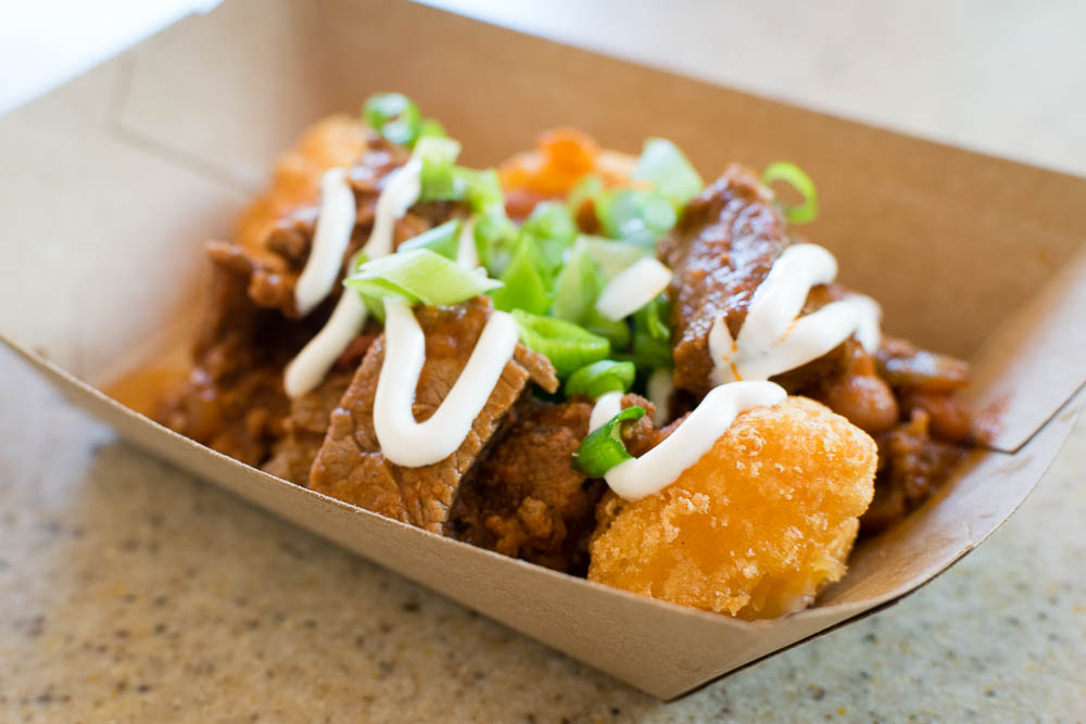 Sweet Corn Nuggets with Beef Chili, Spring Onions, & Sour Cream