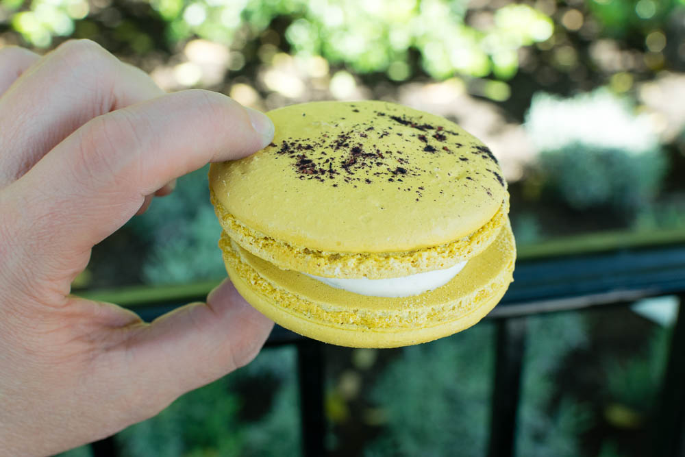 California's White Wine Flight  Meyer Lemon Macaron with Blueberry Marmalade, Meyer Lemon Cream, & Blueberry Dust