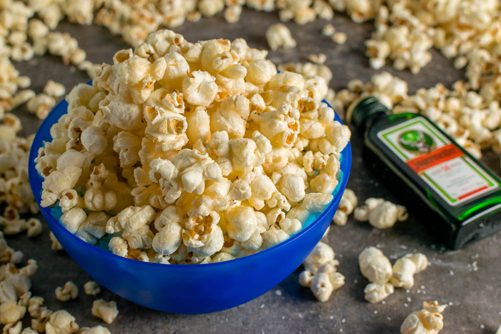 Movie Food | Movie Recipes | Popcorn Recipes | Inspired by the release of Pacific Rim: Uprising, The Geeks have created a punny recipe for Jaeger Glazed Popcorn featuring Jagermeister and Sea Salt. 2geekswhoeat.com