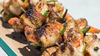 Get out your grills because this Grilled Jalapeno Bacon Wrapped Shrimp from The Geeks is perfect for poolside grilling. 2geekswhoeat.com #bacon #grilling