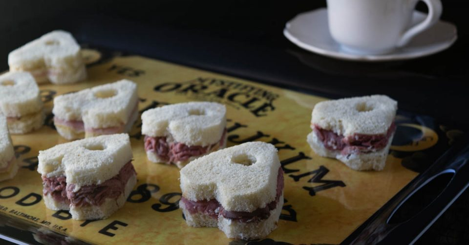 These Ouija inspired tea sandwiches are perfect for a seance or Halloween party. 2geekswhoeat.com #Ouija #Recipe #Halloween