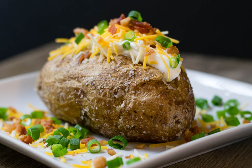 The Geeks share tips and tricks to make the Perfect Baked Potato 2geekswhoeat.com #Potatoes #HowTo