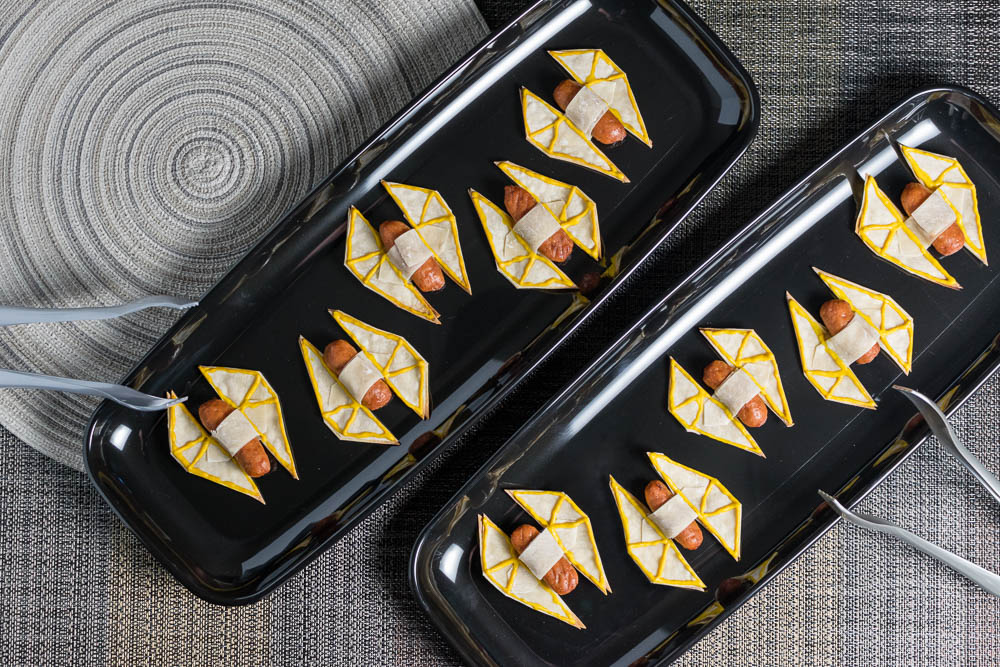 [Sponsored] The Geeks share their 3rd and final Rogue One: A Star Wars Story inspired recipe. They've gone all out with their TIE Striker Appetizers. 2geekswhoeat.com #StarWarsRecipes #StarWars #Appetizers #GeekyRecipes #GeekyFood #StarWarsParty #PartyIdeas