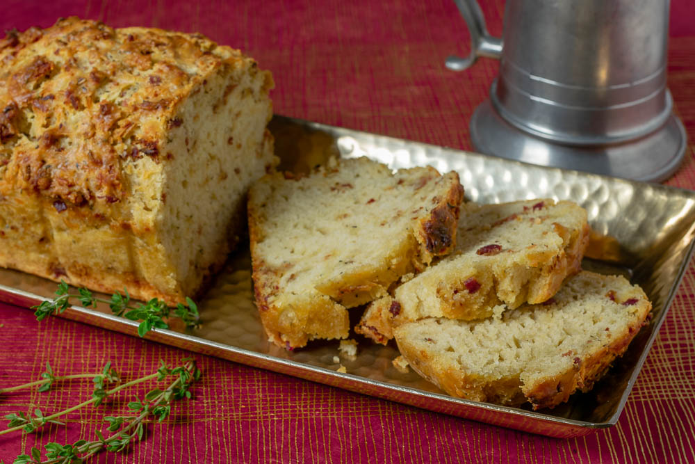 The Geeks have created a Gryffindor themed recipe, Godric's Bacon Cheddar Ale Bread, to celebrate the anniversary of Harry Potter & the Philosopher's Stone. 2geekswhoeat.com #HarryPotter #HarryPotterRecipes #GryffindorRecipes #Baking #BreadRecipes #BeerBread