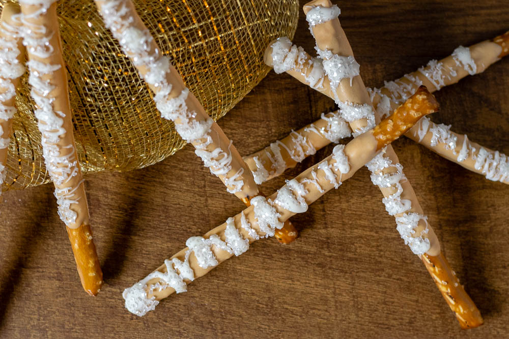 Butterbeer | Harry Potter | Harry Potter Recipes | To celebrate Harry Potter's birthday The Geeks have created a recipe for Butterbeer Pretzel Wands! Not only are they visually appealing but they are delicious as well! 2geekswhoeat.com