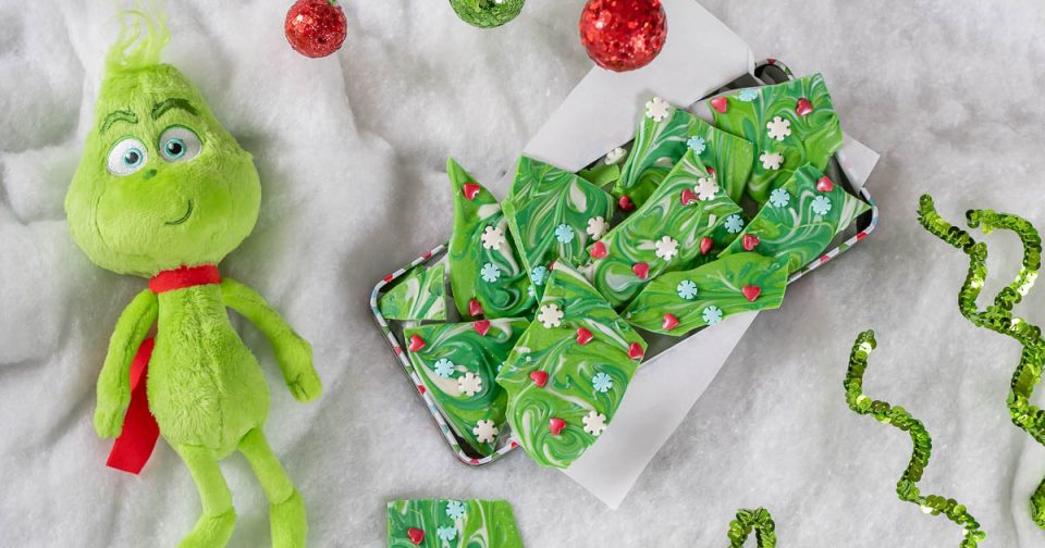 Perfect for a holiday treat or even gift, The Geeks have created a recipe for Grinch-mas Bark inspired by Dr. Suess' The Grinch. 2geekswhoeat.com #TheGrinch #GrinchRecipes #ChristmasRecipes #CandyRecipes