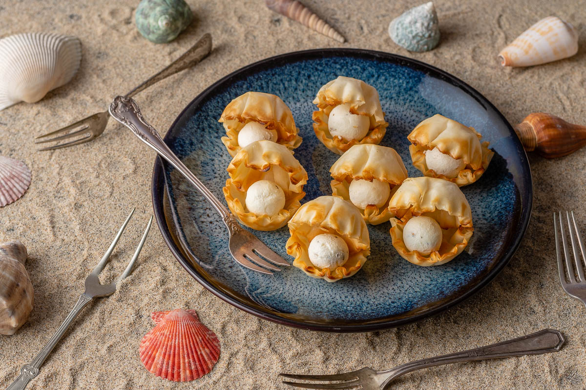 [AD] Disney Recipes | The Little Mermaid | Disney Party Recipes | Princess Party | The celebrate the 30th anniversary of The Little Mermaid, The Geeks have come up with a super easy but cute recipe for Goat Cheese Seashell Bites! This appetizer is sure to please a crowd! 2geekswhoeat.com