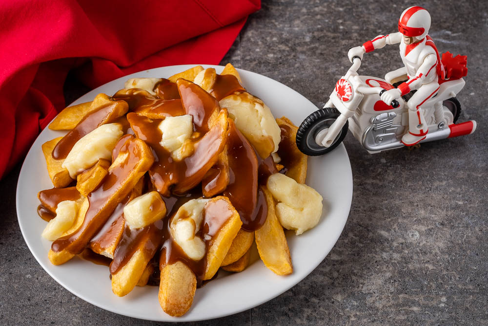The toys are back with new friends in Toy Story 4 and The Geeks have put together a recipe for Poutine inspired by Duke Caboom! 2geekswhoeat.com Toy Story 4 #DisneyFood #DisneyRecipes #PixarFood #Pixar #Disney #Poutine #ToyStory #ToyStory4