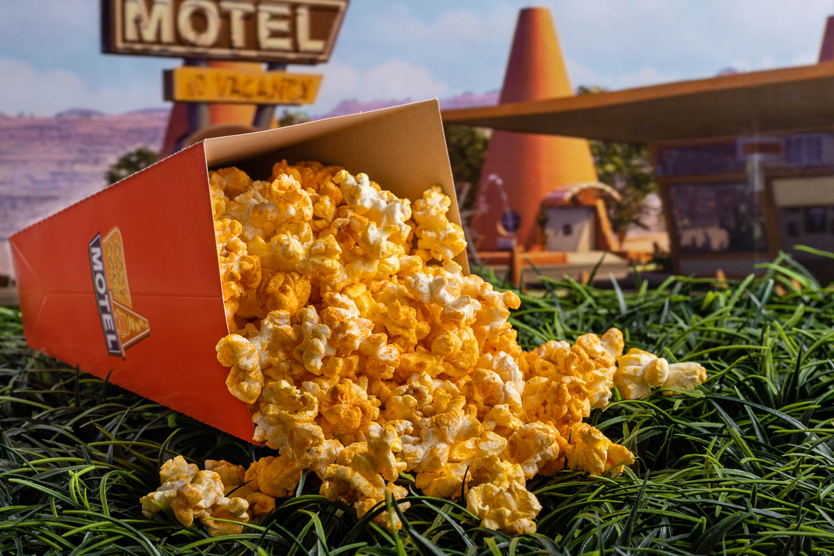 Missing the treats of Cars Land, The Geeks have come up with a copycat recipe for Cozy Cone Buffalo Ranch Popcorn! It will transport you to Cars Land! 2geekswhoeat.com #Disney #DisneyFood #DisneyRecipes #DisneySnacks #DisneyEats #Popcorn #BuffaloRanchPopcorn #GameDayRecipes #SuperBowlFood