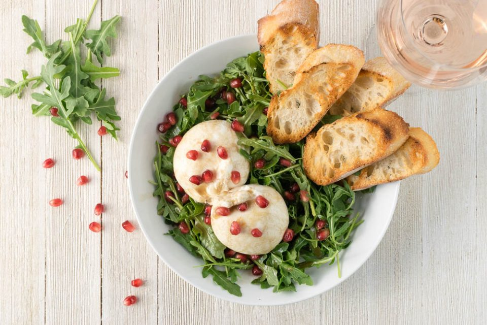 Want a great date night appetizer? The Geeks have created a Burrata Salad with a Pomegranate Vinaigrette featuring Queen Creek Olive Mill Pomegranate White Balsamic Vinegar! [sponsored] 2geekswhoeat.com #DateNight #Cheese #AppetizerRecipes #Mealsfor2