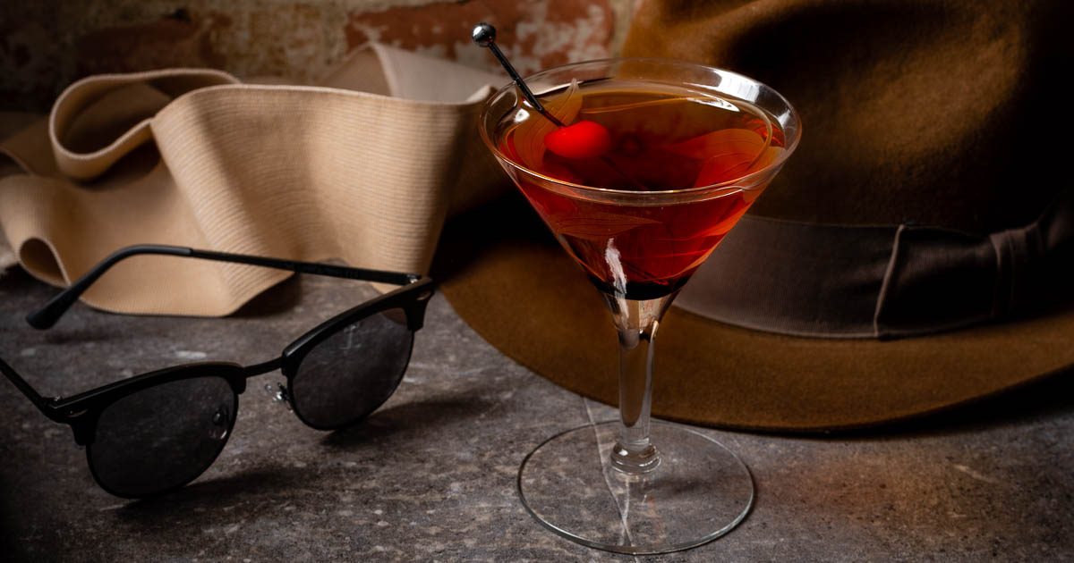 To get ready for the release of Blumhouse's reimagining of Universal's The Invisible Man, The Geeks are sharing a recipe for The Invisible Man-hattan along with tips on how to modernize the classic cocktail! 2geekswhoeat.com #Cocktails #ClassicCocktails #HorrorRecipes #HorrorInspiredFood #HorrorFood #HalloweenIdeas #partyideas #UniversalMonsters