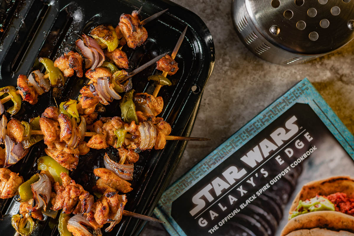 [sponsored] The Geeks review Insight Editions' Star Wars: Galaxy's Edge The Official Black Spire Outpost Cookbook and share a delicious recipe for Gruuvan Shaal Kebabs. 2geekswhoeat.com  #StarWars #StarWarsDay #StarWarsRecipes #StarWarsFood #GeekyFood #GeekyRecipes #cookbookreview