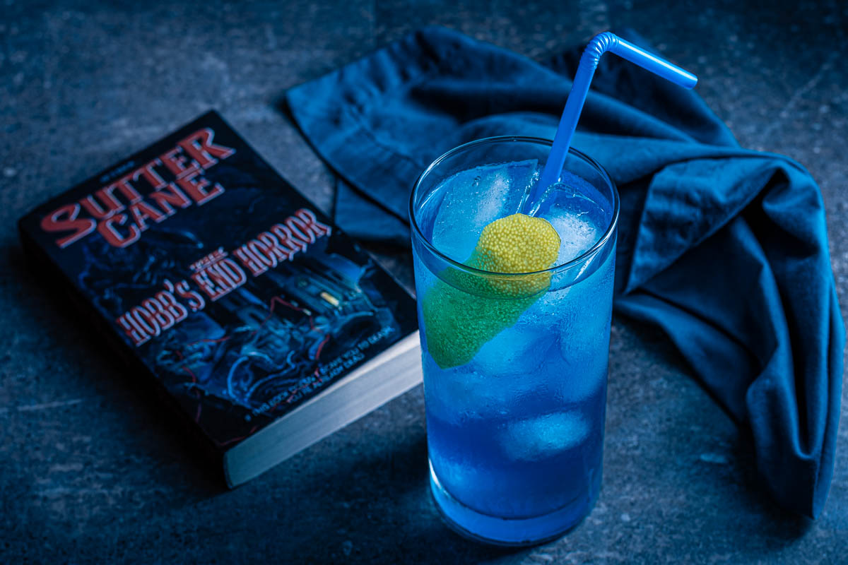 Inspired by John Carpenter's In The Mouth of Madness, The Geeks have created a cocktail perfect for any Sutter Cane fan, the Hobb's End Highball! 2geekswhoeat.com #Cocktails #HomeBartender #HorrorMovieRecipes #HalloweenIdeas #HalloweenParty #MovieNight