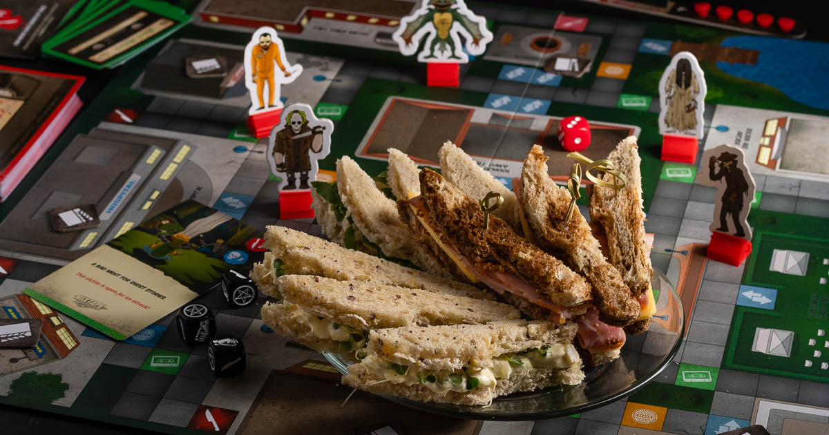 Looking for a macabre snack perfect for a Mixtape Massacre game night? The Geeks have created a recipe for Tall Oak Tea Sandwiches that are perfect for a night of gaming! 2geekswhoeat.com #HorrorRecipes #GameNight #HorrorAppetizers #AppetizerRecipes #MixtapeMassacre #GameInspiredRecipes #GameRecipes #TeaSandwiches