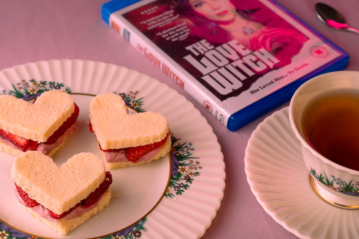 Inspired by Anna Biller's The Love Witch, The Geeks have put together a quick and easy dessert recipe for Tea Love-wiches! 2geekswhoeat.com #ValentinesDay #DessertRecipes #ValentinesDessert #TheLoveWitch #Shudder #HorrorMovieRecipes