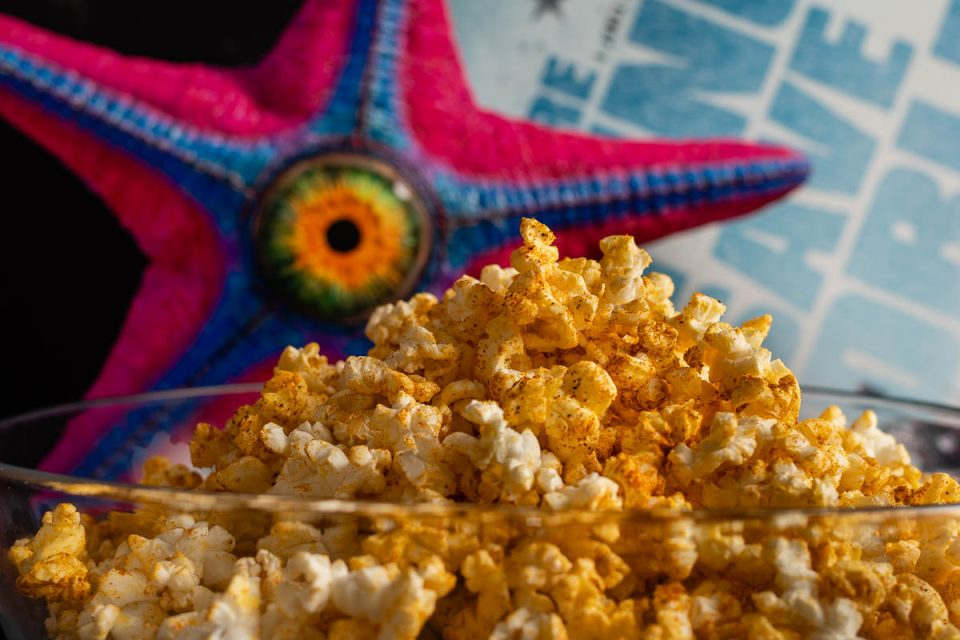To get ready for the release of The Suicide Squad, The Geeks have come up with an empanada flavored popcorn, inspired by the film! 2geekswhoeat.com #TheSuicideSquad #SuperHeroMovies #ComicBookMovies #Popcorn #MovieNight #MovieSnacks